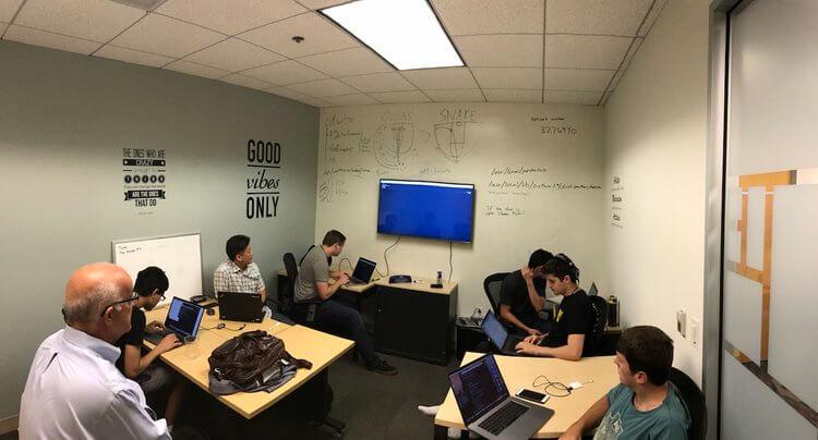 Data scientist interns hard at work with Ken Gardner, the CEO of conDati